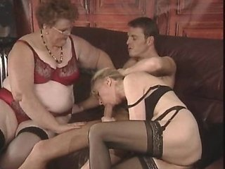 Whoever said these two bitches were too old to wear a young guy down didn't see them in action. Sexy 50 y.o. blonde and her fat cock-loving girlfriend