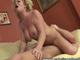Sexy busty granny drilled and sucking young dick