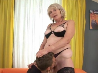 Horny busty granny gilf gives young dude head
