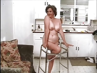 Frisky Granny doing two guys like a Pro